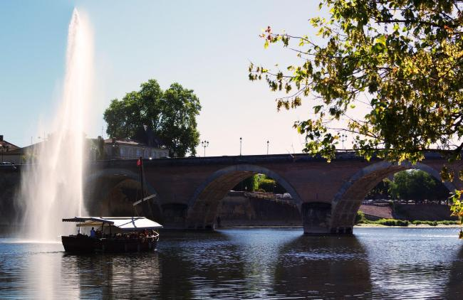 Old bridge in Bergerac seen from the left bank on the Dordogne